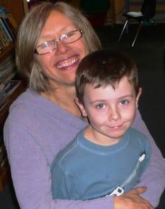 teacher helen holding student