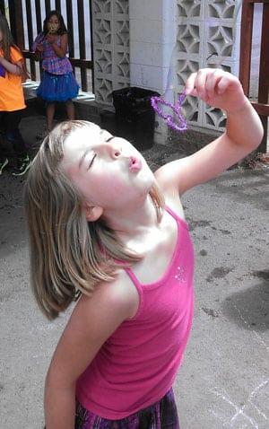 Girl-blowing-bubble-300x478