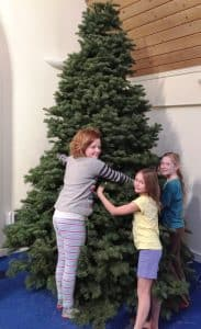 Christmas tree hug Caitlin Raina Sophia