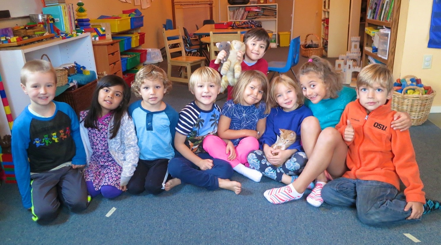 Kindergarten in Beaverton, Oregon with a small class size having fun in the classroom