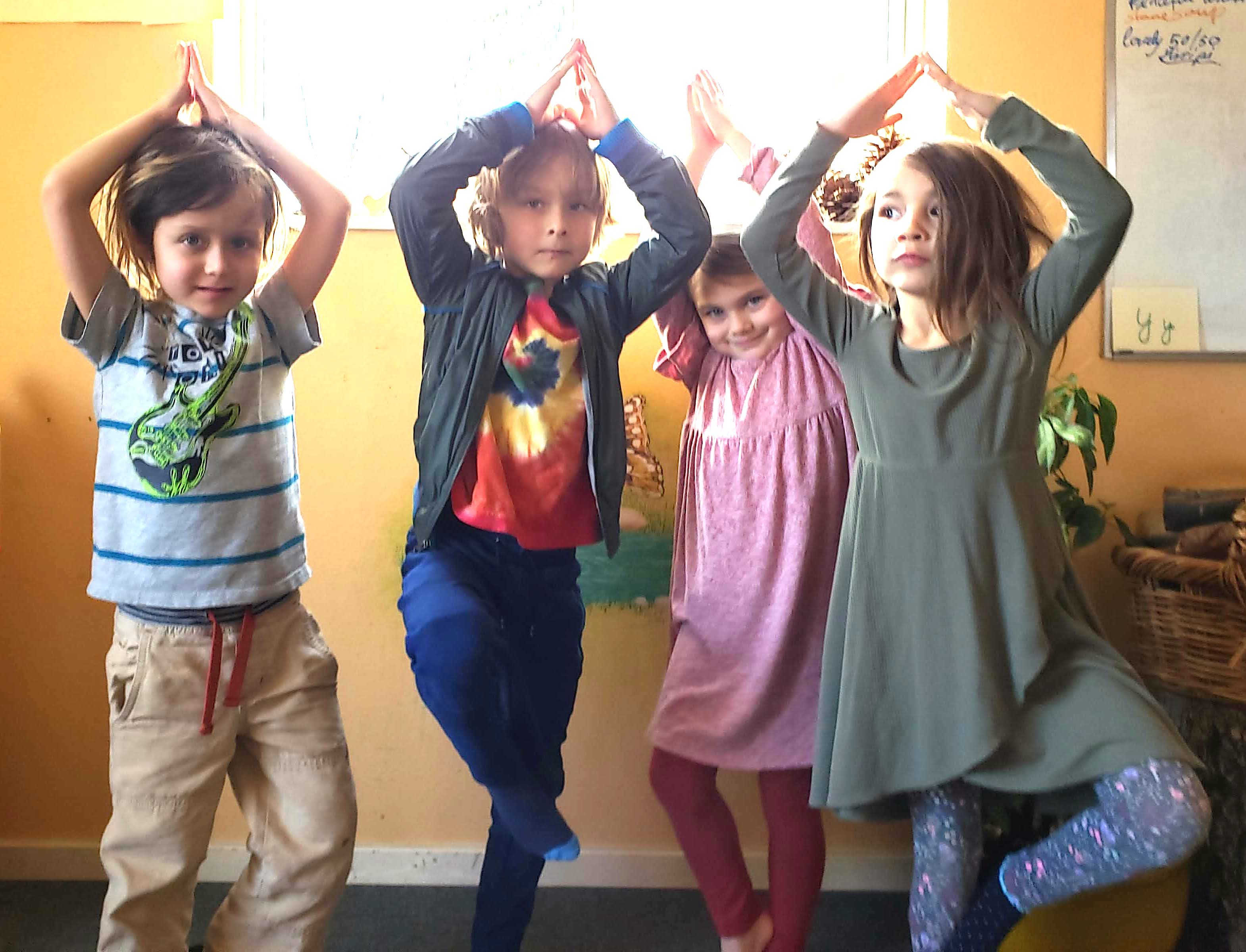 Kindergarten students practicing yoga tree pose in their classroom in Beaverton, Oregon